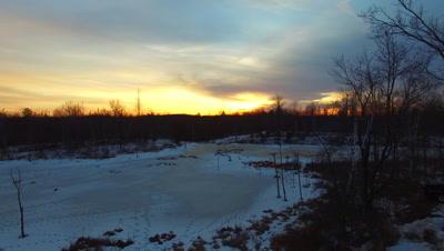 Sunset Over Beaver Pond, Ascending, Small Fire Burning Below