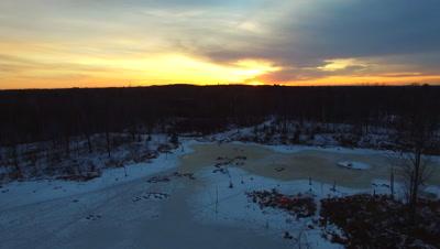 Sunset Over Beaver Pond in Winter, Small Fire Burning