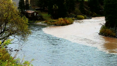 Confluence of the Snake River and Hoback River, as the muddy Hoback mixes with the clear water.