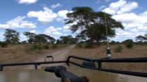 Driving Along A Dirt Road In The Serengeti