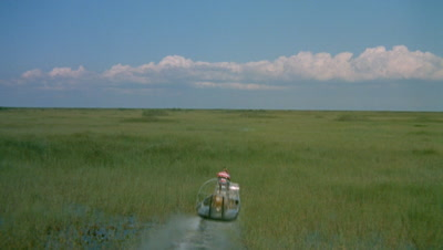 Airboat Glides Over Surface Of Wetland